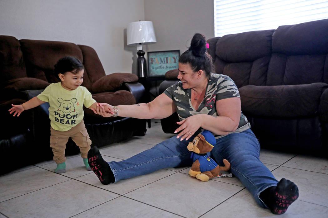 Hanna Olivas juega con su nieto Damián Córdova, de un año, en su casa de Las Vegas el miérc ...