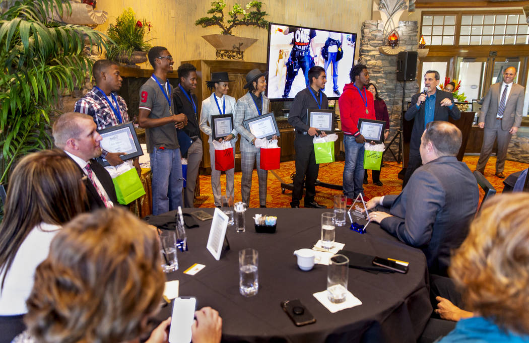 Los miembros de la primera generación de graduados de HomeAid WORKS son felicitados por Nat Ho ...