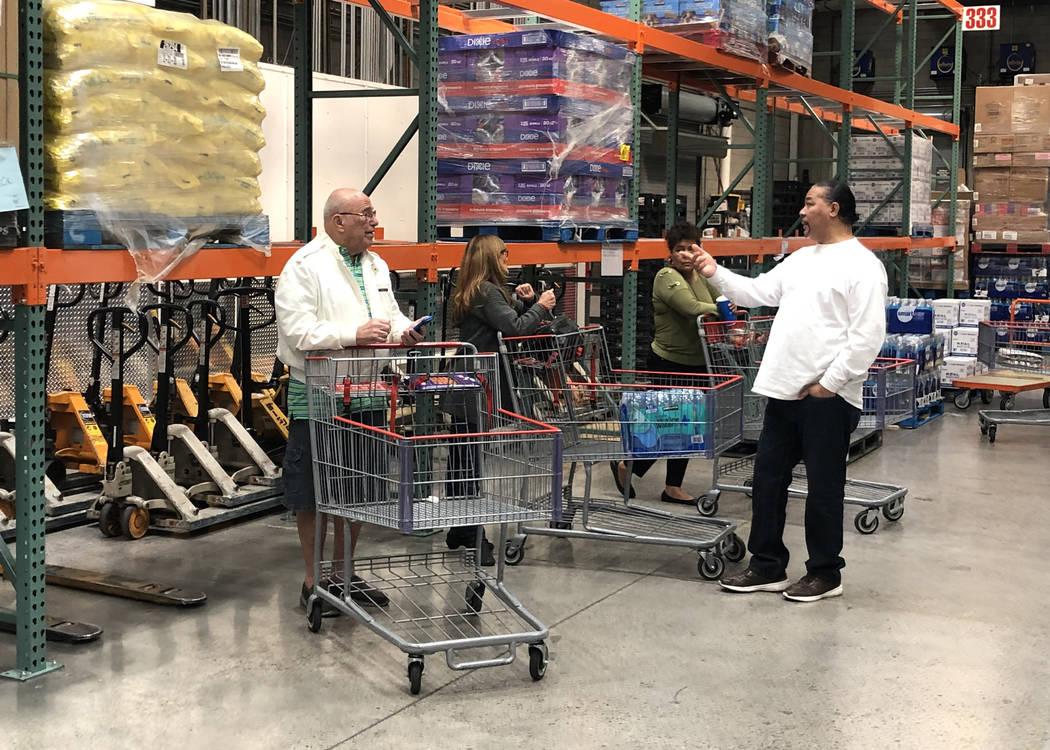 Clientes compran botellas de agua y papel higiénico en un Costco de Henderson el lunes, 2 de m ...