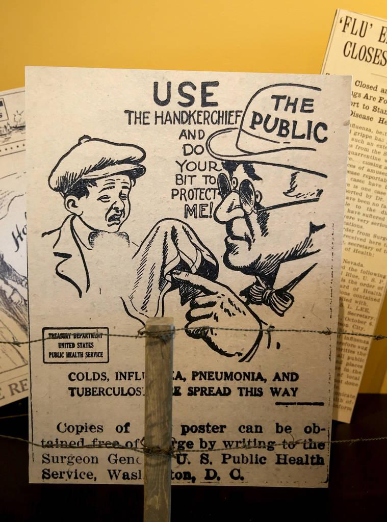 Un póster de la Primera Guerra Mundial dedicada a la pandemia mundial de gripe de 1918 en el M ...