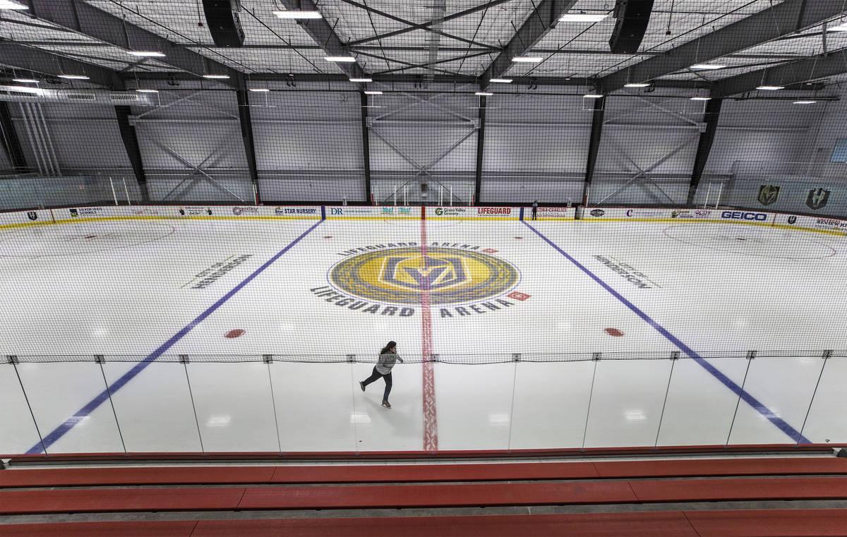 Un patinador cruza el centro del hielo de la pista número dos en Golden Knights' Lifeguard Are ...