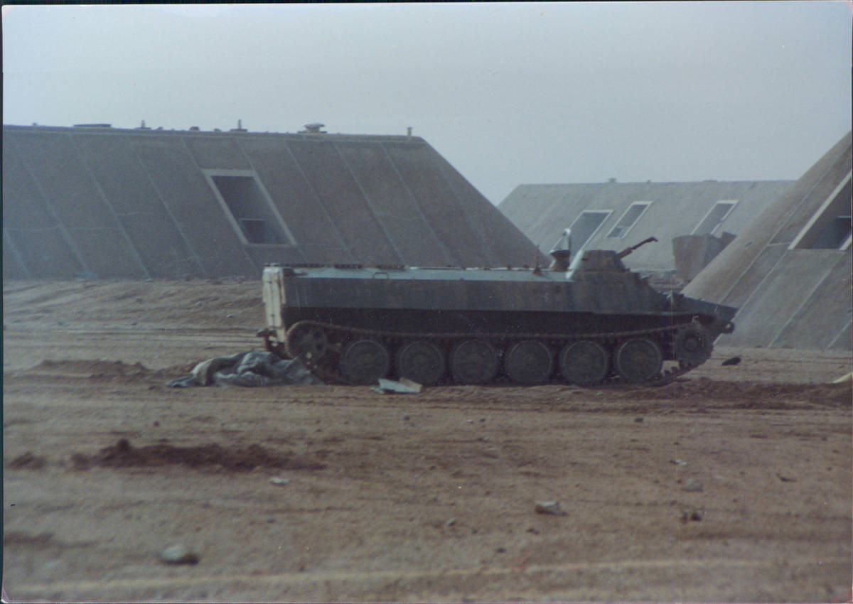 An abandoned Iraqi armored personnel carrier sits at the entrance of Salman Airbase in western ...