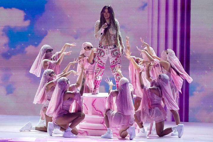 Karol G se presenta para la 21a entrega de los premios Latin Grammy, que se transmitió el juev ...
