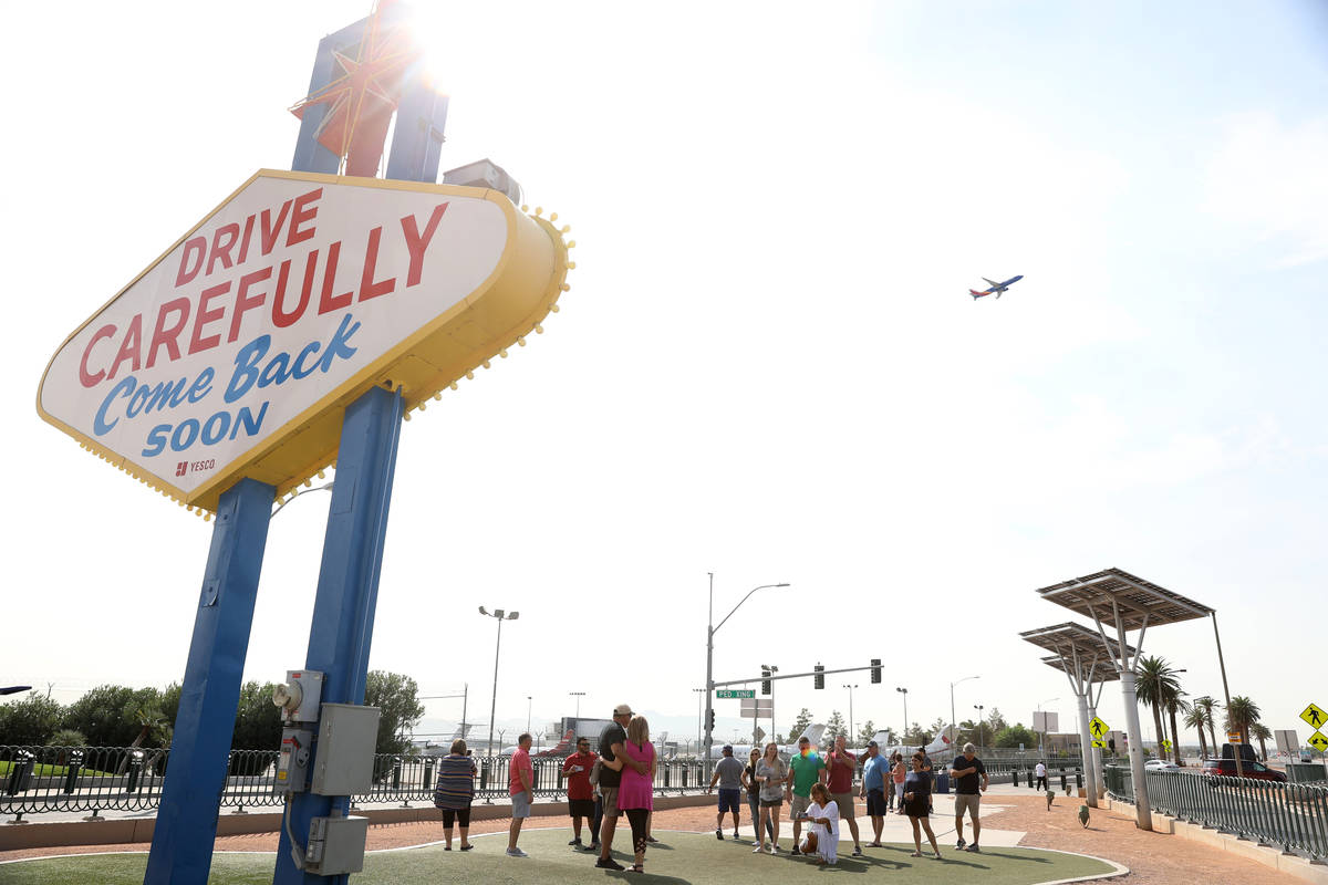 People take photos at the Welcome to Fabulous Las Vegas Sign in Las Vegas, Thursday, Sept. 17, ...