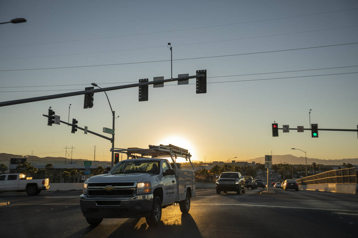 Cars drive across a street to enter the Auto Show Drive onramp to U.S. Highway 95 in Henderson ...