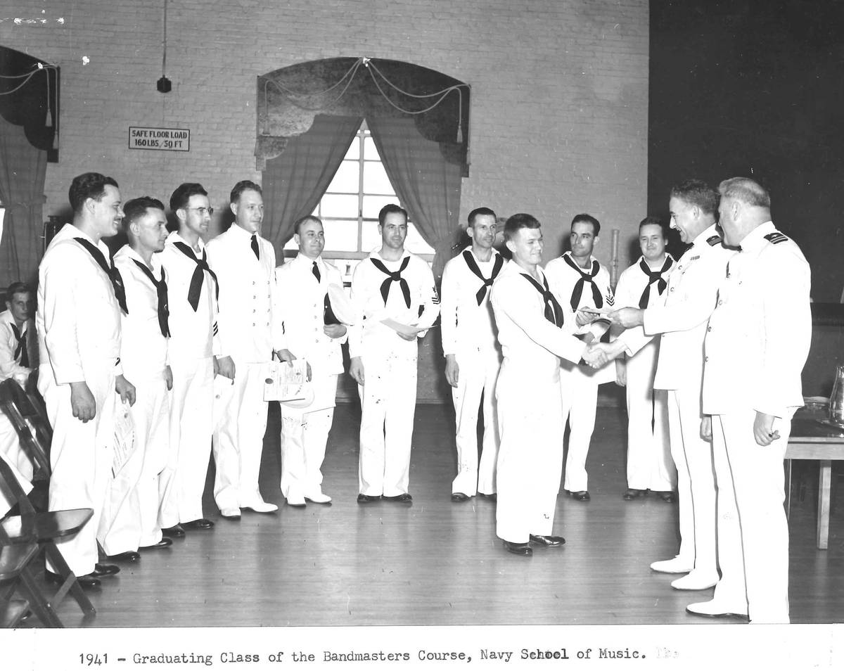 A graduation ceremony at the U.S. Navy School of Music shows U.S.S. Arizona bandmaster Frederic ...