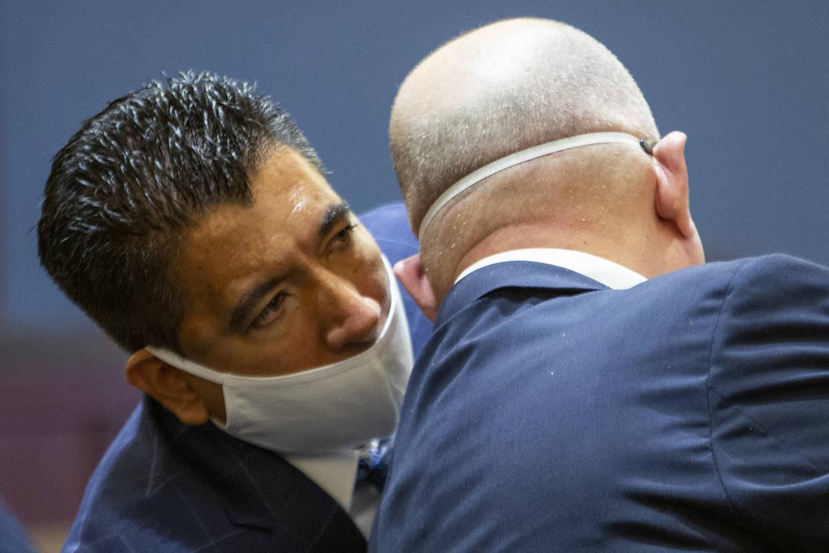 El propietario de Alpine Motel Apartments, Adolfo Orozco, habla con su abogado Dominic Gentile, ...