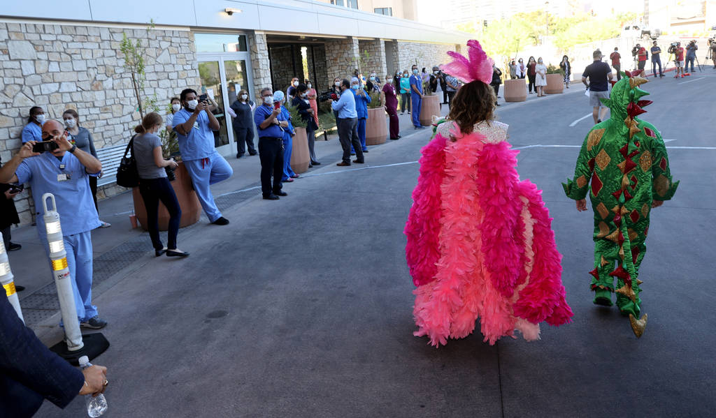 Jade Simone and Piff the Magic Dragon arrive for a show at Sunrise Hospital and Medical Center ...