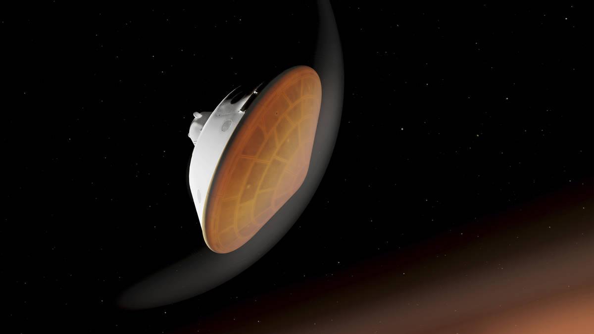 En esta ilustración facilitada por la NASA, el aeroshell que contiene a Perseverance se guía ...
