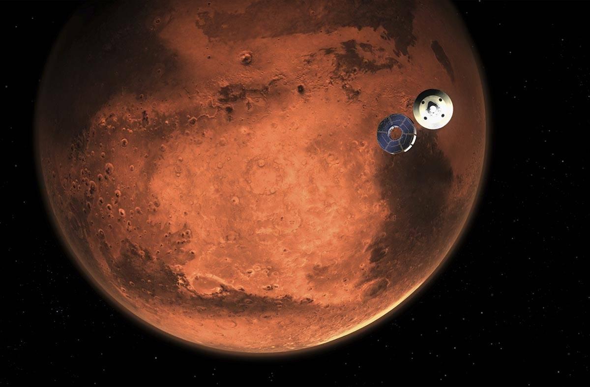 En esta ilustración facilitada por la NASA, el Perseverance se desprende de su nave de transpo ...