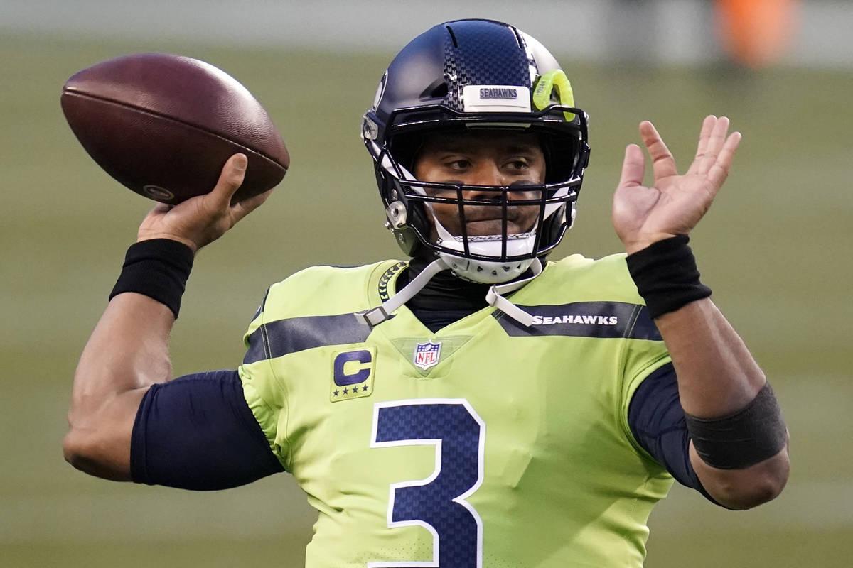 El quarterback de los Seattle Seahawks, Russell Wilson, en acción contra los Arizona Cardinals ...