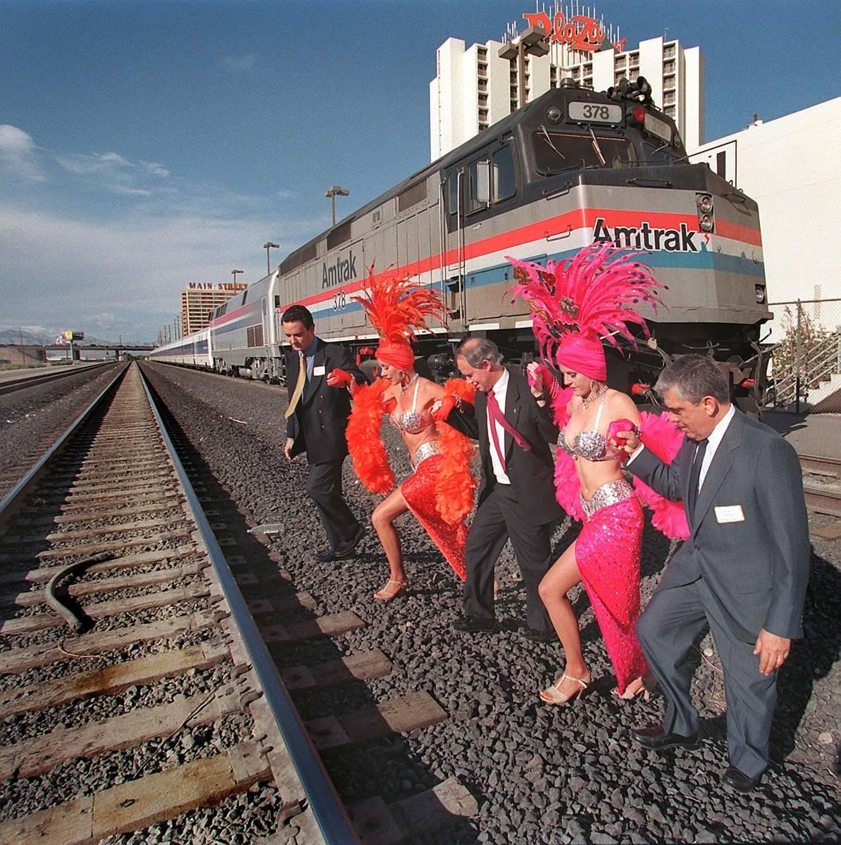 Los ejecutivos del tren Gustavo González, desde la izquierda, Gil Mallery y Lucas Oriol asiste ...