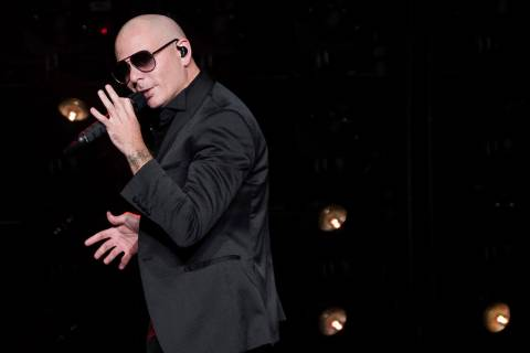 ARCHIVO - En esta fotografía de archivo, del 30 de junio de 2017, Pitbull se presenta en un co ...