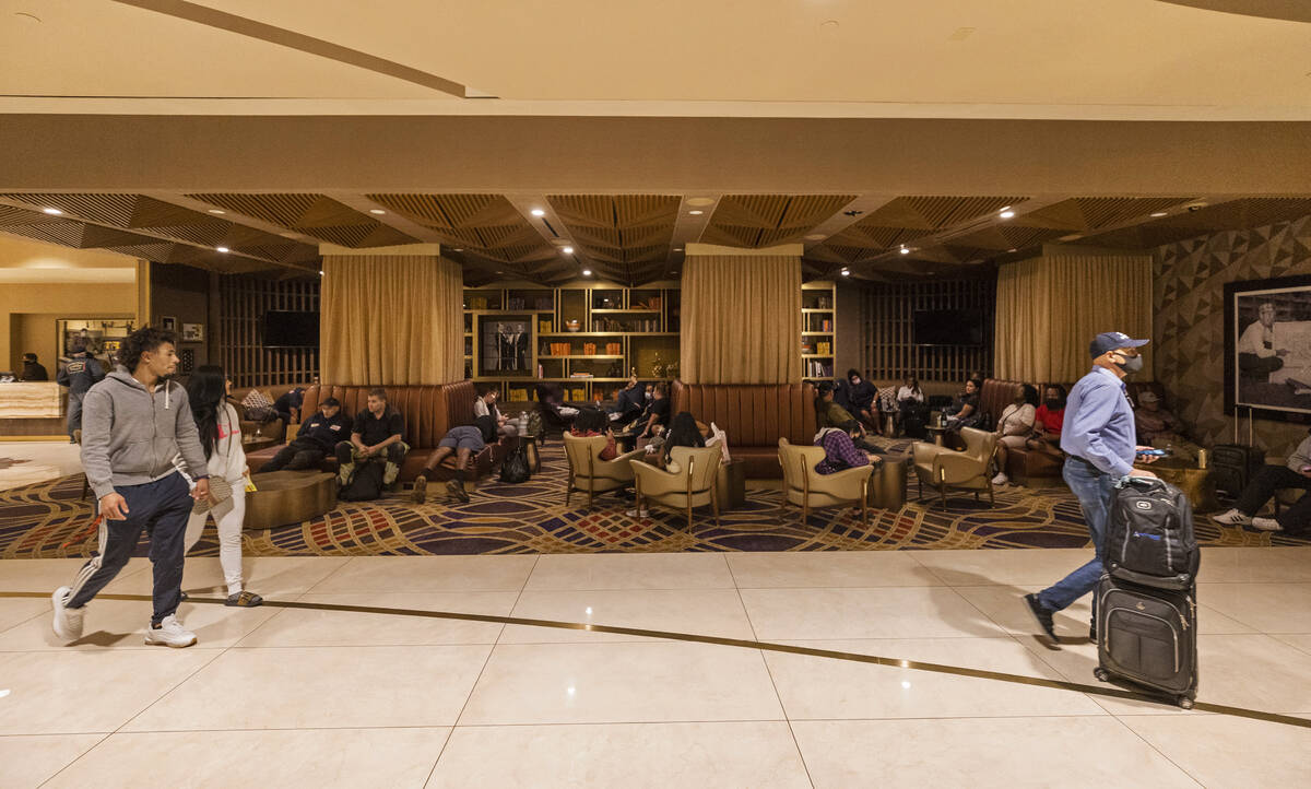 Guests wait in the lobby during a partial power outage at Sahara Las Vegas on Monday, Oct. 11, ...