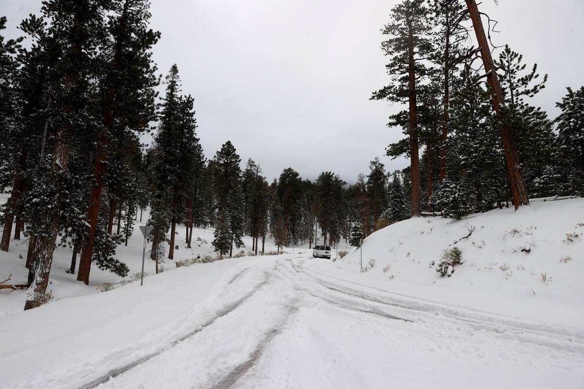 A shuttle van sits stuck in the snow at the Lee Canyon ski area on Mount Charleston northwest o ...