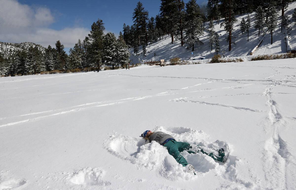 Amy Parker of Las Vegas makes a snow angel in freshly fallen snow in Upper Lee Meadows on Mount ...
