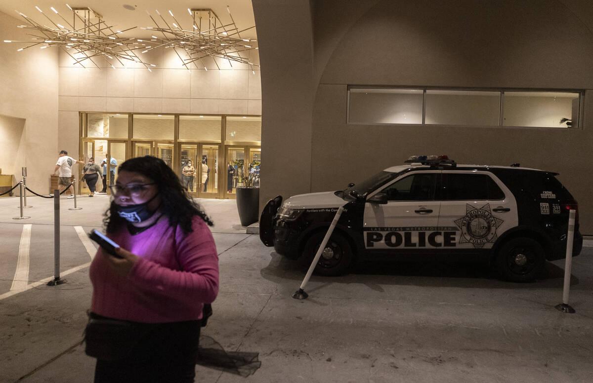 Guests pass Las Vegas Metro vehicles responding to a partial power outage at Sahara Las Vegas o ...