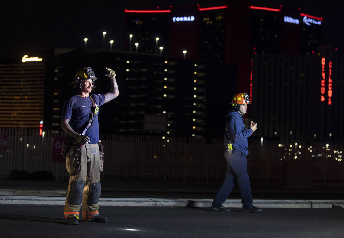 Las Vegas Fire & Rescue respond to people trapped in an elevator during a power outage near ...