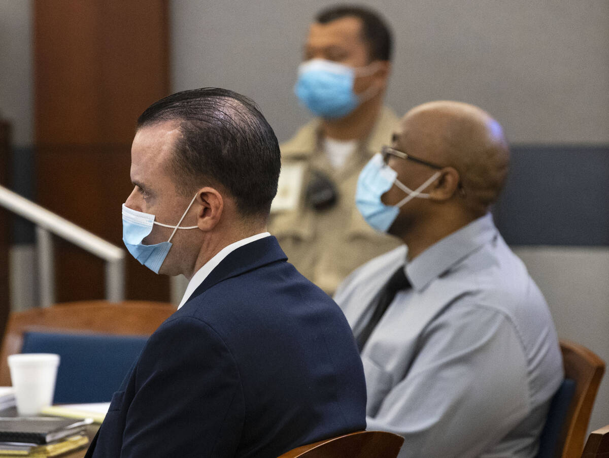 Michael Rusk, 28, left, and Cortrayer Zone, 38, appear in court during their murder trial at th ...